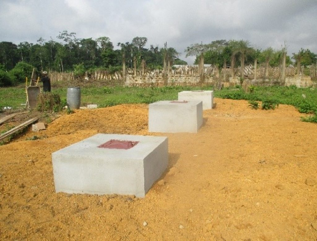Three separate waste disposal pits for placentas, ash and sharps at Kpallah Clinic in Nimba County, after intervention.