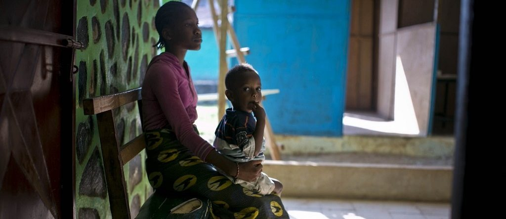 A mother and her child waiting to see a doctor in Liberia.