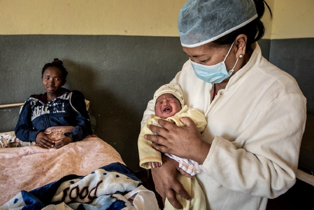 Mother, midwife and one-day-old baby in Madagascar