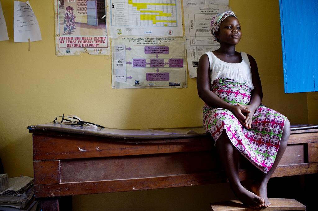 17-year-old Maria, pregnant with her second child, waits to be examined at a clinic in Liberia.