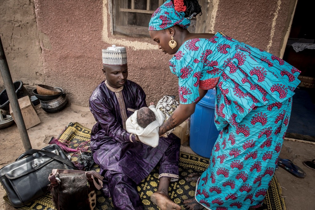 As he prepares to shave her son, he stresses health messages to Nafisatu.