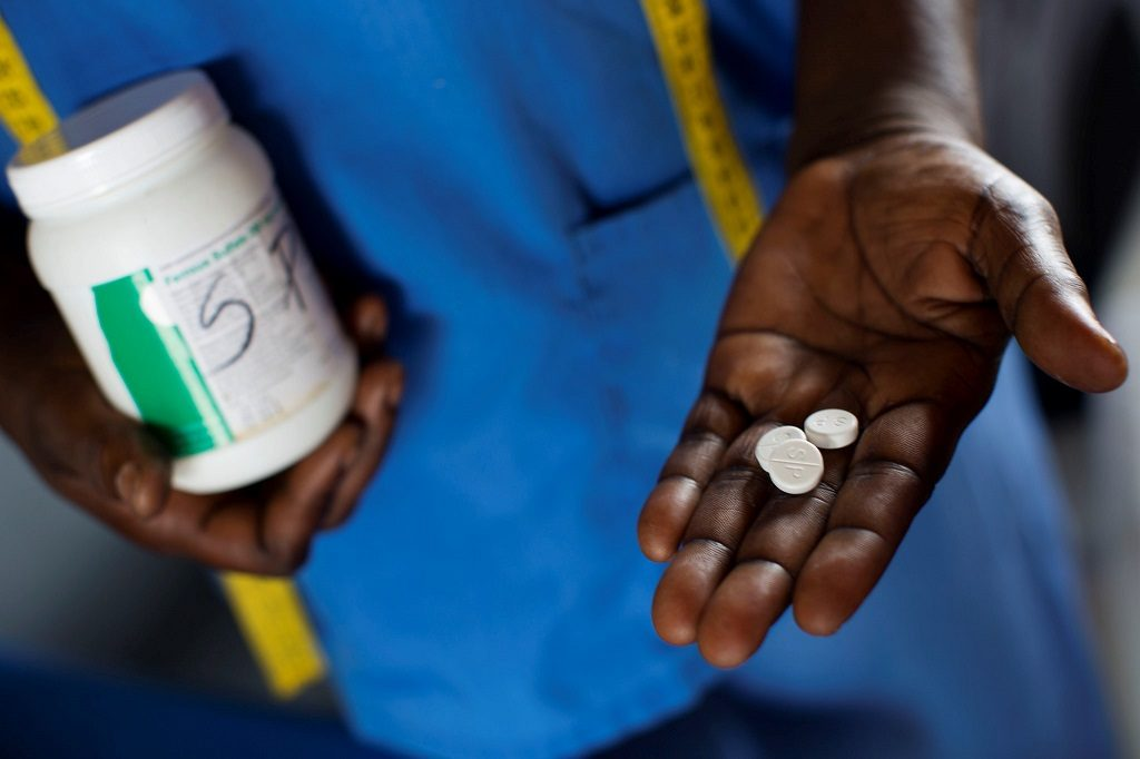 A health worker administers malaria prophylaxis drugs to pregnant women at a facility in DR Congo.