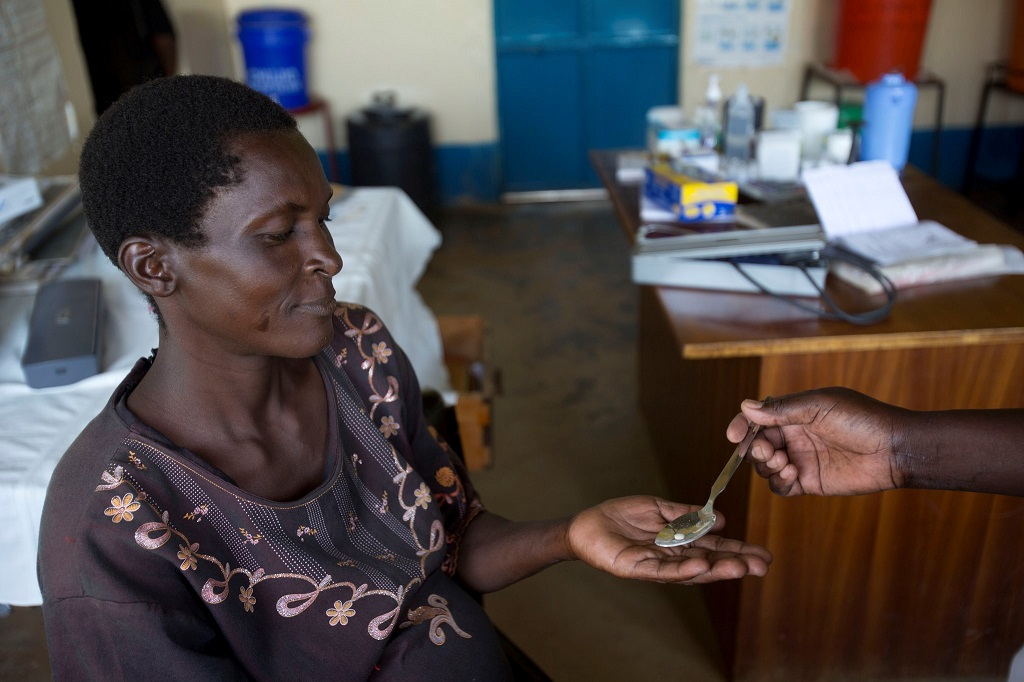 A pregnant woman receives malaria prevention medicine at a clinic in Kenya.