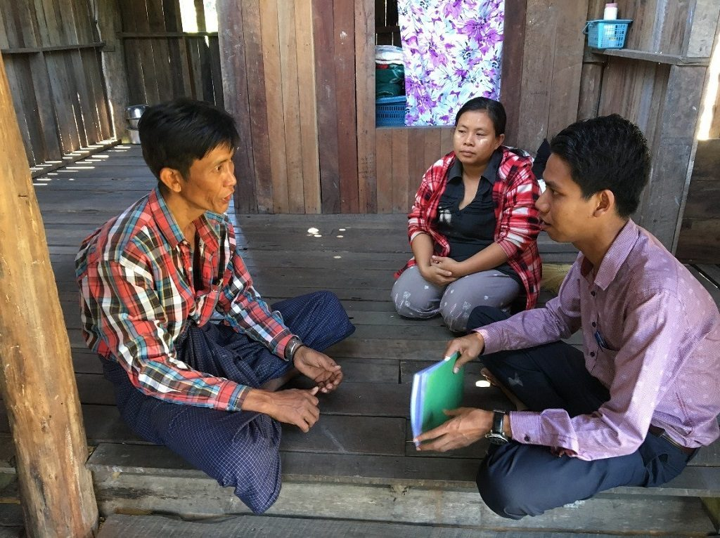 Ko Maung Tun speaking with MCSP-trained ICMVs, Dr. Thu Naing and Nan Nyein Nyein Ei, about his TB diagnosis and the support he received from Ei.