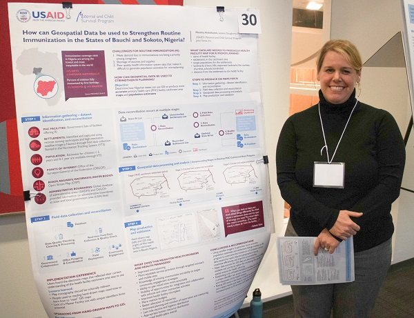 MCSP's Leanne Dougherty presenting her poster on using geospatial data to strengthen routine immunization in Nigeria.