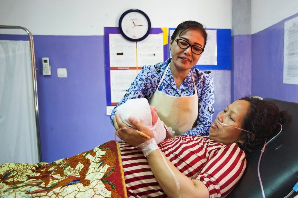 Woman and newborn in Indonesian health facility