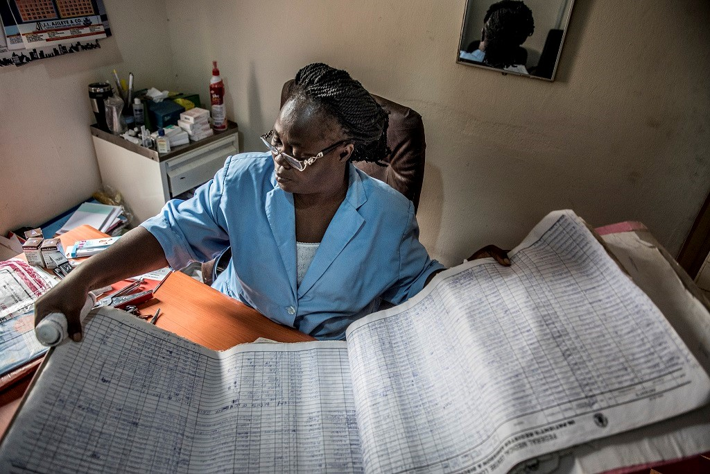 Rosemary Amaje, maternity ward manager at Nigeria's Lokoja Federal Medical Center, checks patient data in the log book
