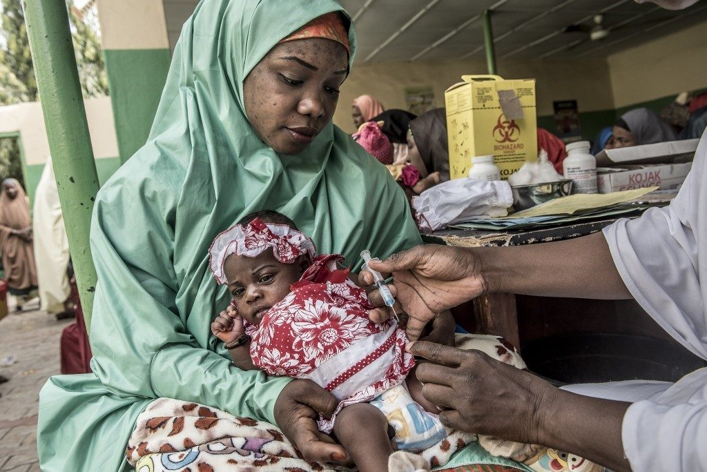 A child is vaccinated at the Women and Children Welfare Hospital in Sokoto