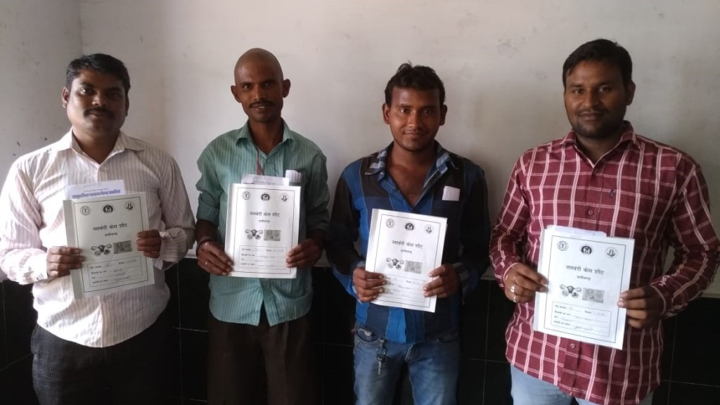 Men who have undergone NSV at an MCSP-supported facility proudly show their paperwork.