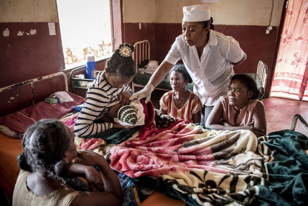 Midwife Haingomalala Roilande Richter checks on mothers in a maternal ward in Madagascar.