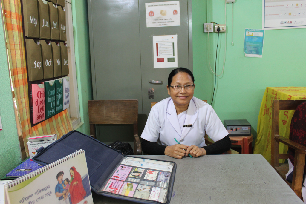 Auxiliary Nurse Midwife Kunjamani Singha, a trusted face in her community, with MCSP's family planning flipbook and counseling kit.