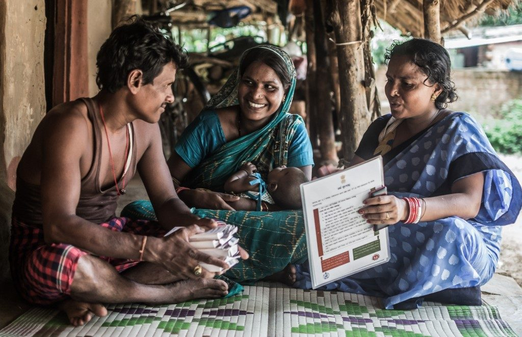 Married couple Jyoti Rani and Pratap Patra meet with Lakshmi Demi, the local community health worker, to discuss family planning options.