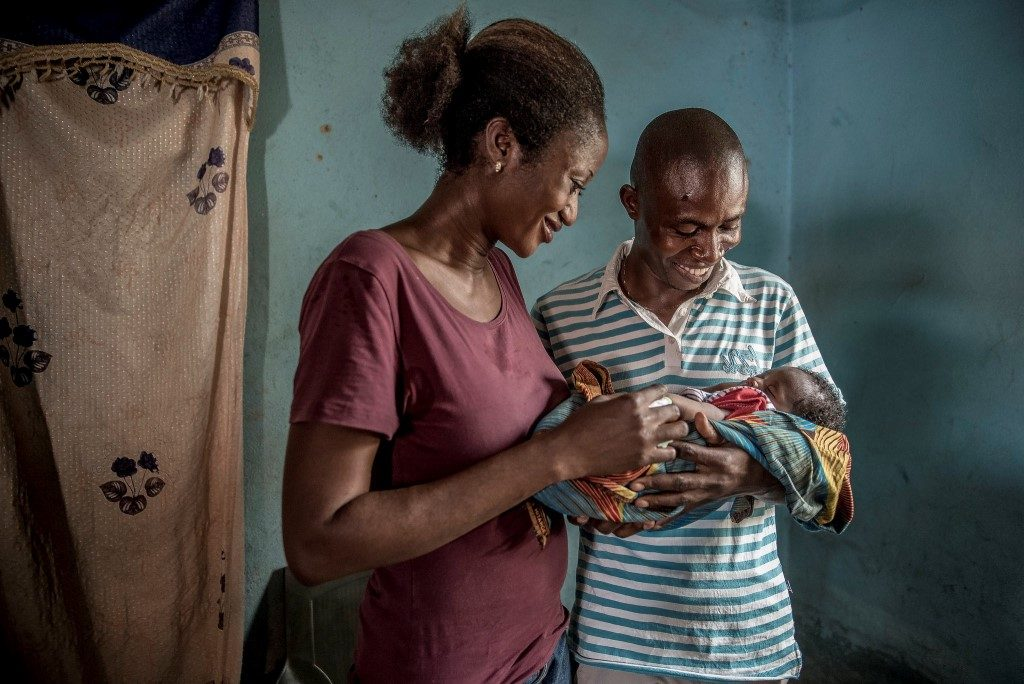 Husband and wife with baby in Nigeria.