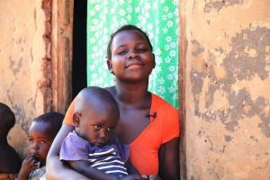 A mother with her child who was successfully classified and treated for an ear infection and pneumonia by an MCSP-supported health facility.
