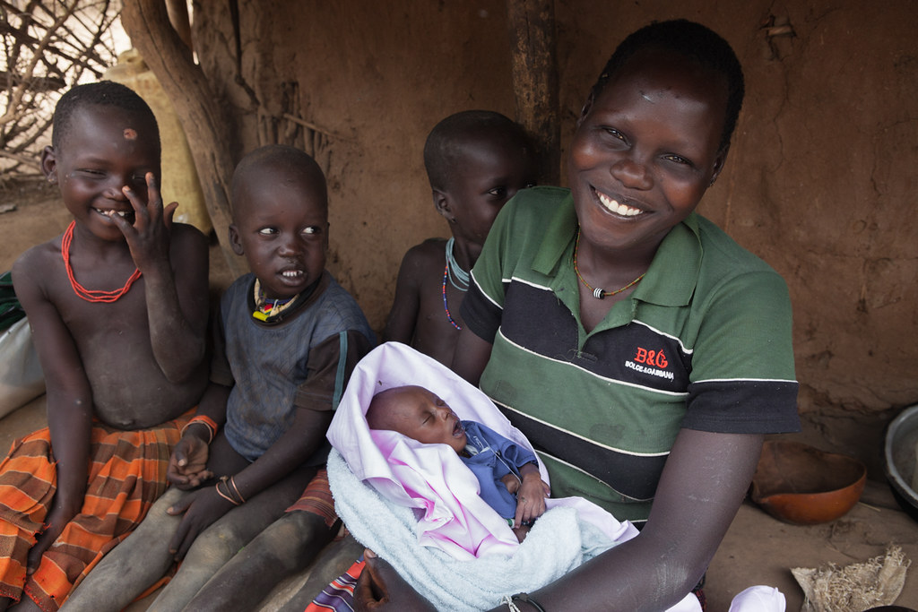 A Ugandan mother and her children at home.